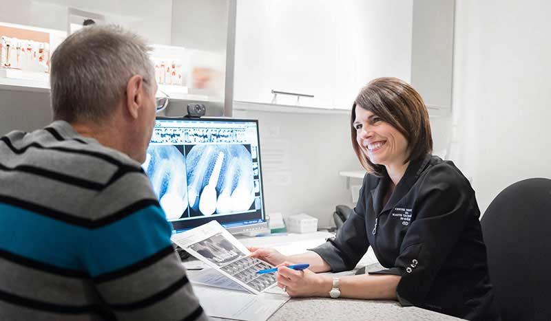 Carole Ratynski, our coordinator, with a patient.